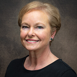 Liz, practice administrator for 16 years and currently manages Cary and Fuquay branch