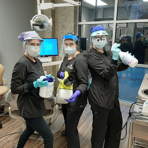 Our team members showing our tools and equipment for disinfecting