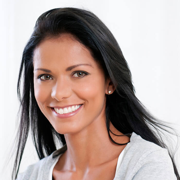 A female patient confidently smiling