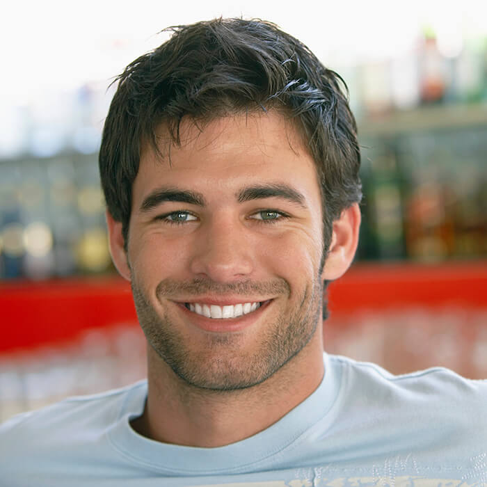 A man showing his pearly white smile