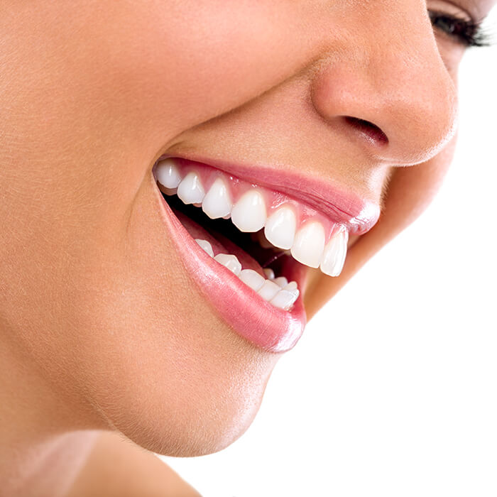 A pearly white teeth is shown while smiling